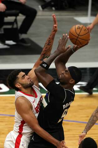 MILWAUKEE, WISCONSIN - MAY 07: Bobby Portis #9 of the Milwaukee Bucks shoots over Anthony Lamb #33 of the Houston Rockets during the second half of a game at Fiserv Forum on May 07, 2021 in Milwaukee, Wisconsin. NOTE TO USER: User expressly acknowledges and agrees that, by downloading and or using this photograph, User is consenting to the terms and conditions of the Getty Images License Agreement. (Photo by Stacy Revere/Getty Images) Photo: Stacy Revere/Getty Images / 2021 Getty Images