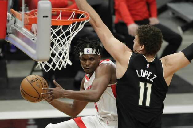 Houston Rockets' Danuel House Jr. (4) passes the ball around Milwaukee Bucks' Brook Lopez (11) during the first half of an NBA basketball game Friday, May 7, 2021, in Milwaukee. (AP Photo/Aaron Gash) Photo: Aaron Gash/Associated Press / Copyright 2021 The Associated Press. All rights reserved.