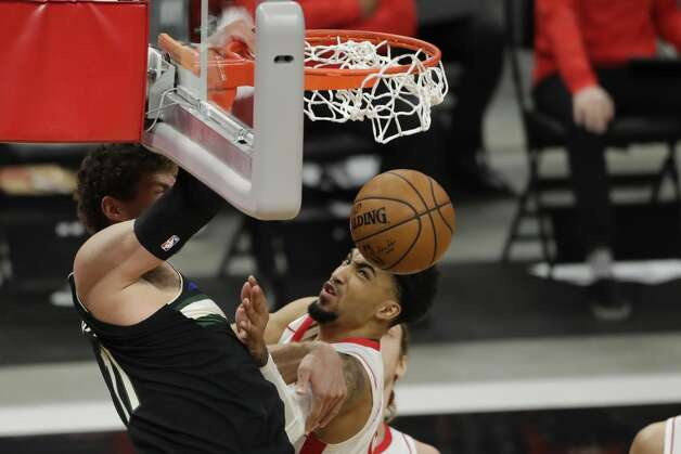 Milwaukee Bucks' Brook Lopez (11) dunks over Houston Rockets' Kenyon Martin Jr. during the second half of an NBA basketball game Friday, May 7, 2021, in Milwaukee. (AP Photo/Aaron Gash) Photo: Aaron Gash/Associated Press / Copyright 2021 The Associated Press. All rights reserved.