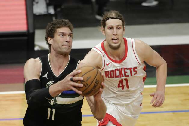 Milwaukee Bucks' Brook Lopez (11) drives to the basket against Houston Rockets' Kelly Olynyk (41) during the second half of an NBA basketball game Friday, May 7, 2021, in Milwaukee. (AP Photo/Aaron Gash) Photo: Aaron Gash/Associated Press / Copyright 2021 The Associated Press. All rights reserved.