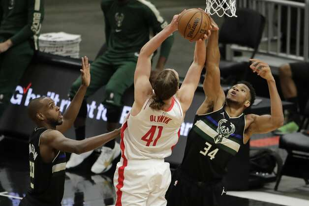 Houston Rockets' Kelly Olynyk (41) is fouled by Milwaukee Bucks' Giannis Antetokounmpo (34) during the second half of an NBA basketball game Friday, May 7, 2021, in Milwaukee. (AP Photo/Aaron Gash) Photo: Aaron Gash/Associated Press / Copyright 2021 The Associated Press. All rights reserved.