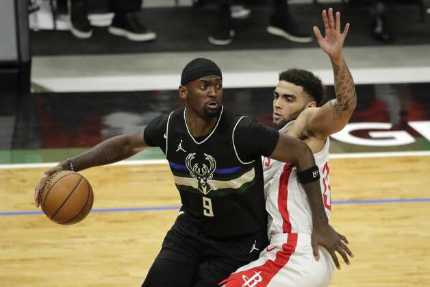 Milwaukee Bucks' Bobby Portis (9) drives to the basket against Houston Rockets' Anthony Lamb during the second half of an NBA basketball game Friday, May 7, 2021, in Milwaukee. (AP Photo/Aaron Gash) Photo: Aaron Gash/Associated Press / Copyright 2021 The Associated Press. All rights reserved.