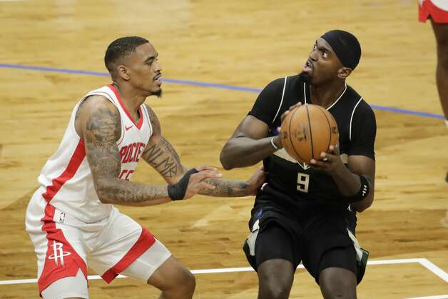 Milwaukee Bucks' Bobby Portis looks to the basket as Houston Rockets' DaQuan Jeffries defends during the second half of an NBA basketball game Friday, May 7, 2021, in Milwaukee. (AP Photo/Aaron Gash) Photo: Aaron Gash/Associated Press / Copyright 2021 The Associated Press. All rights reserved.