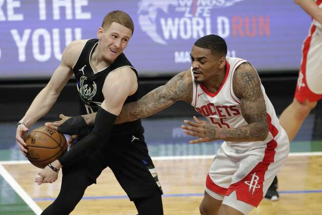Houston Rockets' DaQuan Jeffries (55) knocks the ball out of the hands of Milwaukee Bucks' Donte DiVincenzo during the second half of an NBA basketball game Friday, May 7, 2021, in Milwaukee. (AP Photo/Aaron Gash) Photo: Aaron Gash/Associated Press / Copyright 2021 The Associated Press. All rights reserved.