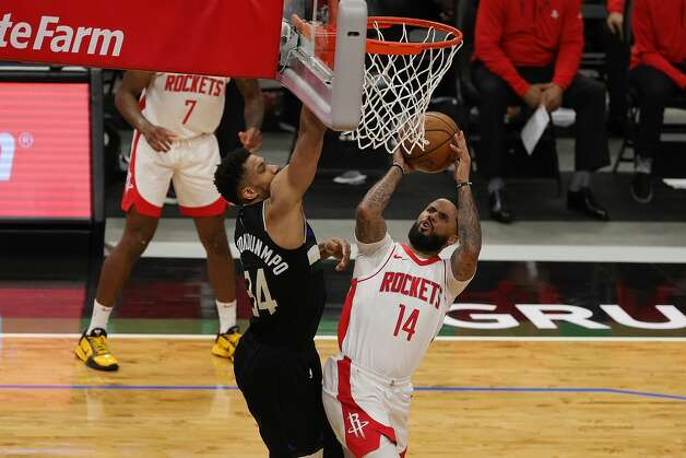 MILWAUKEE, WISCONSIN - MAY 07: D.J. Augustin #14 of the Houston Rockets drives to the basket against Giannis Antetokounmpo #34 of the Milwaukee Bucks during the first half of a game at Fiserv Forum on May 07, 2021 in Milwaukee, Wisconsin. NOTE TO USER: User expressly acknowledges and agrees that, by downloading and or using this photograph, User is consenting to the terms and conditions of the Getty Images License Agreement. (Photo by Stacy Revere/Getty Images) Photo: Stacy Revere/Getty Images / 2021 Getty Images