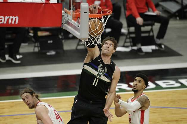 Milwaukee Bucks' Brook Lopez (11) dunks over Houston Rockets' Kelly Olynyk (41) and Kenyon Martin Jr. (6) during the second half of an NBA basketball game Friday, May 7, 2021, in Milwaukee. (AP Photo/Aaron Gash) Photo: Aaron Gash/Associated Press / Copyright 2021 The Associated Press. All rights reserved.