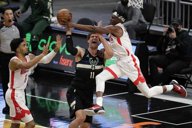 Milwaukee Bucks' Brook Lopez (11) is fouled by Houston Rockets' Danuel House Jr. during the first half of an NBA basketball game Friday, May 7, 2021, in Milwaukee. (AP Photo/Aaron Gash) Photo: Aaron Gash/Associated Press / Copyright 2021 The Associated Press. All rights reserved.