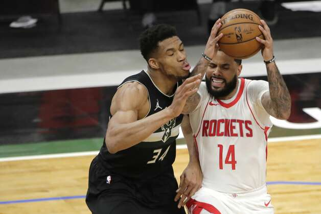 Houston Rockets' D.J. Augustin (14) drives to the basket against Milwaukee Bucks' Giannis Antetokounmpo (34) during the first half of an NBA basketball game Friday, May 7, 2021, in Milwaukee. (AP Photo/Aaron Gash) Photo: Aaron Gash/Associated Press / Copyright 2021 The Associated Press. All rights reserved.