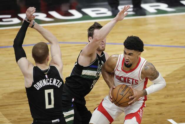 Houston Rockets' Kenyon Martin Jr., right, drives to the basket against Milwaukee Bucks' Pat Connaughton, middle, and Donte DiVincenzo, left, during the first half of an NBA basketball game Friday, May 7, 2021, in Milwaukee. (AP Photo/Aaron Gash) Photo: Aaron Gash/Associated Press / Copyright 2021 The Associated Press. All rights reserved.