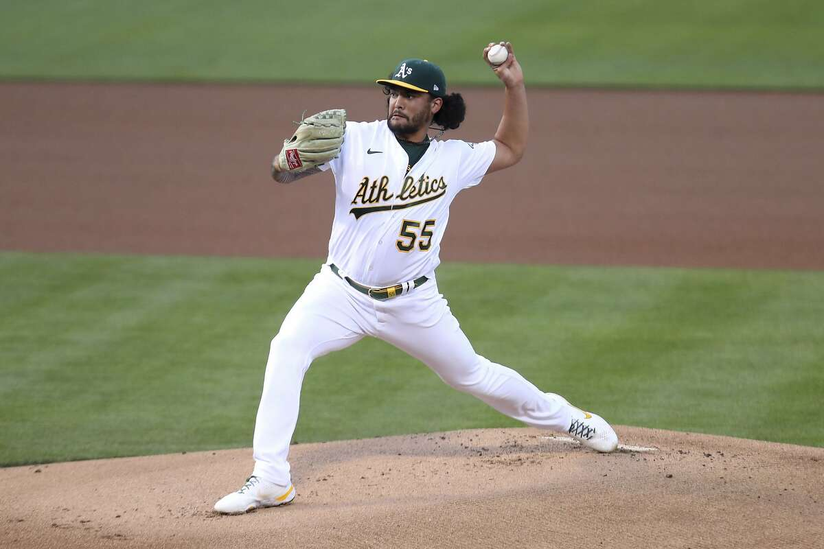 Oakland Athletics' Sean Manaea throws to a Tampa Bay Rays batter during the first inning of a baseball game in Oakland, Calif., Friday, May 7, 2021. (AP Photo/Jed Jacobsohn)