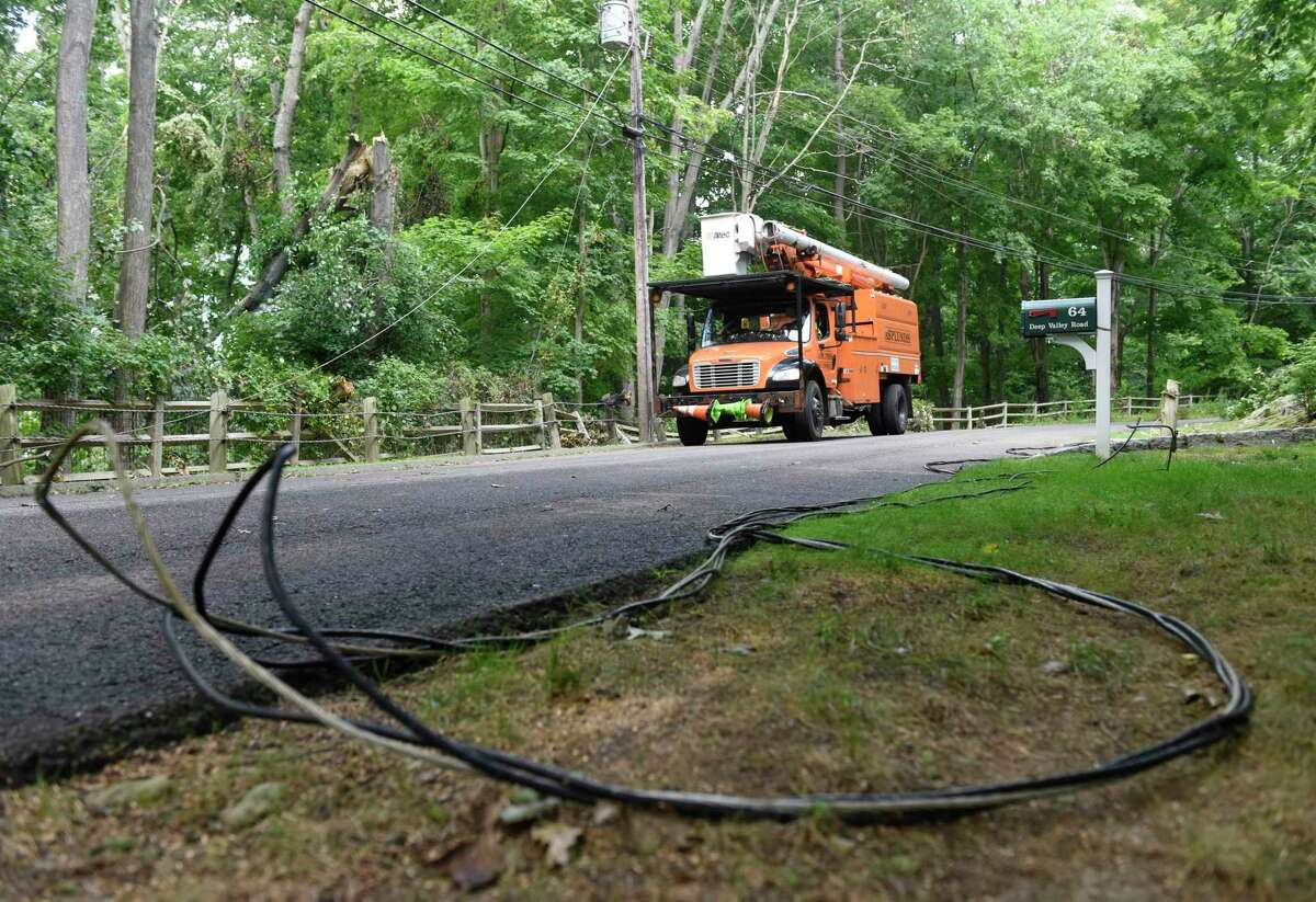 Crews examine downed trees and power lines knocked down during Tropical Storm Isaias on Deep Valley Road in North Stamford, Conn. Wednesday, Aug. 12, 2020.