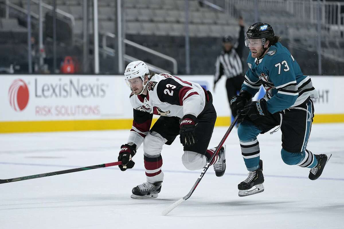 San Jose Sharks center Noah Gregor (73) and Arizona Coyotes defenseman Oliver Ekman-Larsson (23) skate after the puck during the first period of an NHL hockey game Friday, May 7, 2021, in San Jose, Calif. (AP Photo/Tony Avelar)