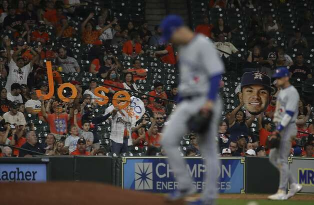 Fans cheer as Houston Astros second baseman Jose Altuve (27) bats during the sixth inning of an MLB game Friday, May 7, 2021, at Minute Maid Park in Houston. Photo: Jon Shapley/Staff Photographer / © 2021 Houston Chronicle