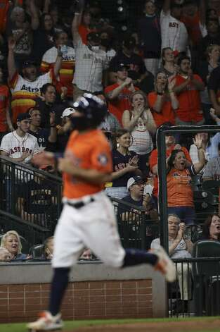 Fans cheer as Houston Astros second baseman Jose Altuve (27) scores on a double by third baseman Alex Bregman (2) during the eighth inning of an MLB game Friday, May 7, 2021, at Minute Maid Park in Houston. Photo: Jon Shapley/Staff Photographer / © 2021 Houston Chronicle