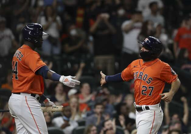 Houston Astros designated hitter Yordan Alvarez (44) and second baseman Jose Altuve (27) celebrate as Altuve scores on a double by third baseman Alex Bregman (2) during the eighth inning of an MLB game Friday, May 7, 2021, at Minute Maid Park in Houston. Photo: Jon Shapley/Staff Photographer / © 2021 Houston Chronicle