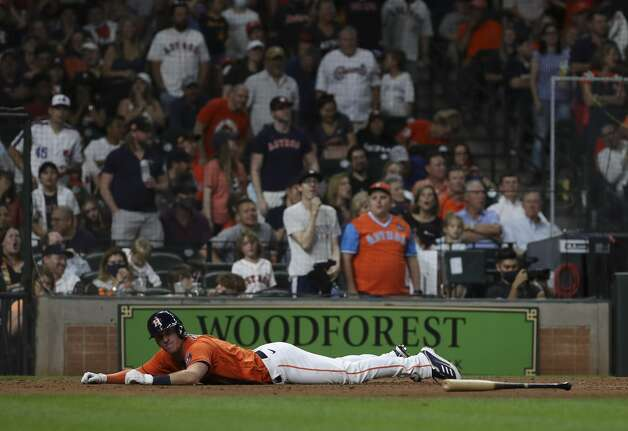 Houston Astros center fielder Myles Straw (3) lays on the ground at home after being tagged out by Toronto Blue Jays catcher Danny Jansen (9) during the sixth inning of an MLB game Friday, May 7, 2021, at Minute Maid Park in Houston. Photo: Jon Shapley/Staff Photographer / © 2021 Houston Chronicle