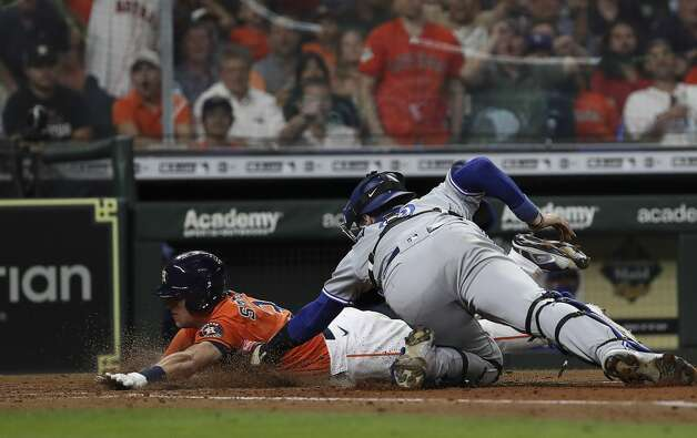 Toronto Blue Jays catcher Danny Jansen (9) tags out Houston Astros center fielder Myles Straw (3) at home during the sixth inning of an MLB game Friday, May 7, 2021, at Minute Maid Park in Houston. Photo: Jon Shapley/Staff Photographer / © 2021 Houston Chronicle
