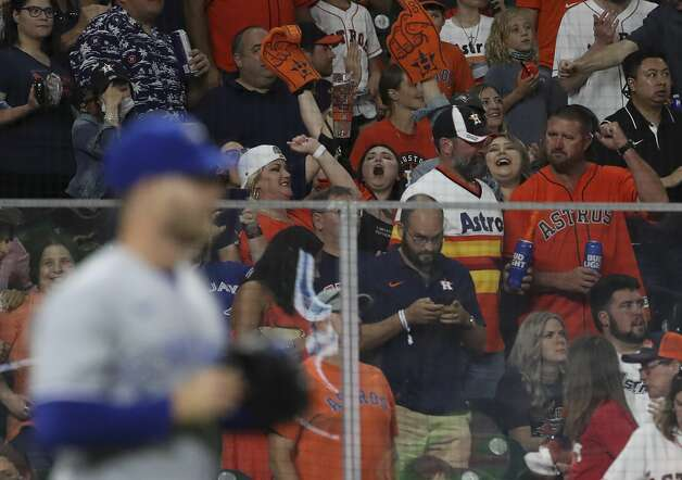 Fans cheer after Houston Astros left fielder Kyle Tucker (30) hit an RBI double during the seventh inning of an MLB game Friday, May 7, 2021, at Minute Maid Park in Houston. Photo: Jon Shapley/Staff Photographer / © 2021 Houston Chronicle