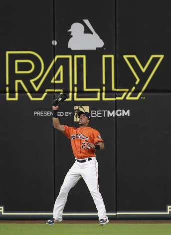 Houston Astros left fielder Michael Brantley (23) catches a ball hit by Toronto Blue Jays second baseman Marcus Semien (10) during the eighth inning of an MLB game Friday, May 7, 2021, at Minute Maid Park in Houston. Photo: Jon Shapley/Staff Photographer / © 2021 Houston Chronicle