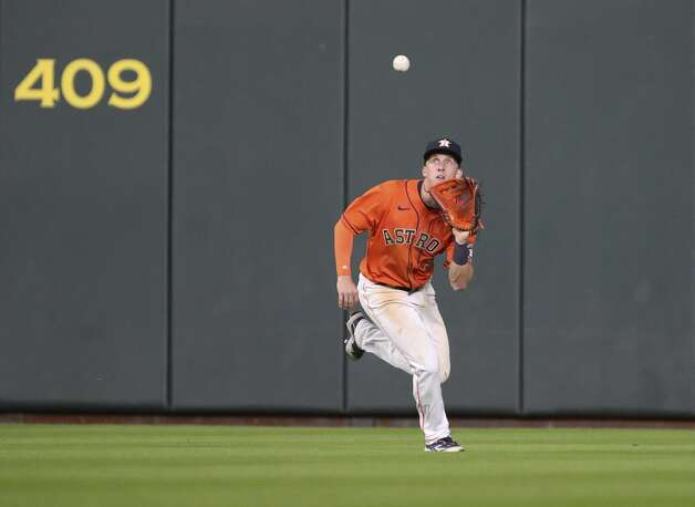Houston Astros center fielder Myles Straw (3) catches a ball hit by Toronto Blue Jays catcher Danny Jansen (9) during the eighth inning of an MLB game Friday, May 7, 2021, at Minute Maid Park in Houston. Photo: Jon Shapley/Staff Photographer / © 2021 Houston Chronicle