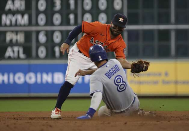 Houston Astros left fielder Michael Brantley (23) tags out Toronto Blue Jays third baseman Cavan Biggio (8) at second base as he attempts to steal during the fifth inning of an MLB game Friday, May 7, 2021, at Minute Maid Park in Houston. Photo: Jon Shapley/Staff Photographer / © 2021 Houston Chronicle