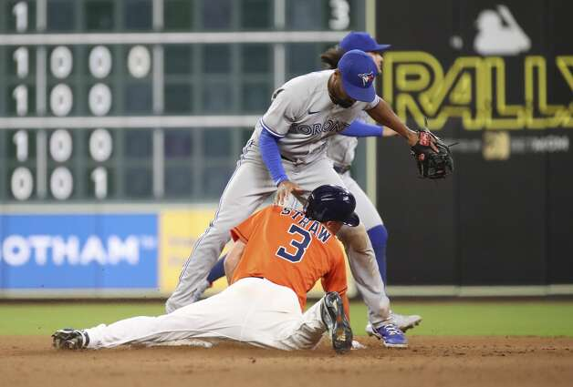 Houston Astros center fielder Myles Straw (3) slides into Toronto Blue Jays second baseman Marcus Semien (10) while attempting to steal second base during the fourth inning of an MLB game Friday, May 7, 2021, at Minute Maid Park in Houston. Houston Astros center fielder Myles Straw (3) returned to first base safely after second baseman Jose Altuve (27) flew out. Photo: Jon Shapley/Staff Photographer / © 2021 Houston Chronicle