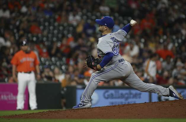 Toronto Blue Jays relief pitcher Ty Tice (60) pitches during the sixth inning of an MLB game Friday, May 7, 2021, at Minute Maid Park in Houston. Photo: Jon Shapley/Staff Photographer / © 2021 Houston Chronicle