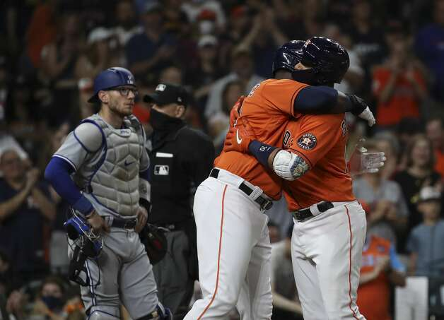 Houston Astros first baseman Yuli Gurriel (10) huts designated hitter Yordan Alvarez (44) after Gurriel hit a home run during the fifth inning of an MLB game Friday, May 7, 2021, at Minute Maid Park in Houston. Photo: Jon Shapley/Staff Photographer / © 2021 Houston Chronicle