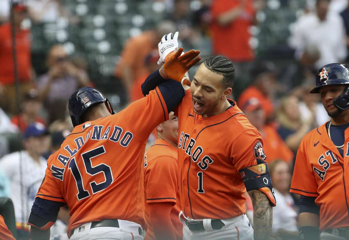 Houston Astros shortstop Carlos Correa (1) celebrates with Houston Astros catcher Martin Maldonado (15) after hitting a home run during the second inning of an MLB game Friday, May 7, 2021, at Minute Maid Park in Houston.