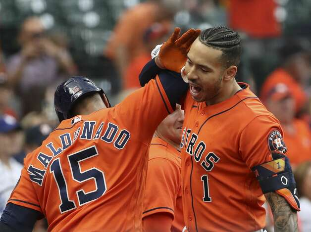 Houston Astros shortstop Carlos Correa (1) celebrates with Houston Astros catcher Martin Maldonado (15) after hitting a home run during the second inning of an MLB game Friday, May 7, 2021, at Minute Maid Park in Houston. Photo: Jon Shapley/Staff Photographer / © 2021 Houston Chronicle