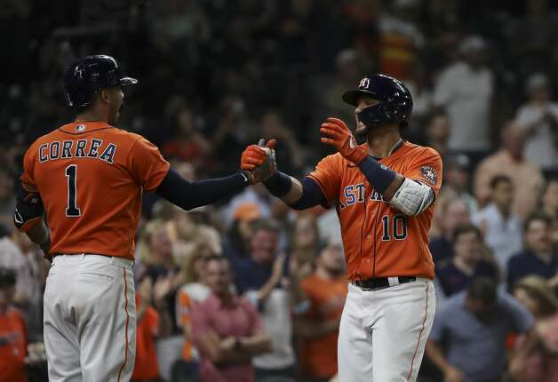 Houston Astros first baseman Yuli Gurriel (10) celebrates with shortstop Carlos Correa (1) after he hit a home run during the fifth inning of an MLB game Friday, May 7, 2021, at Minute Maid Park in Houston. Photo: Jon Shapley/Staff Photographer / © 2021 Houston Chronicle