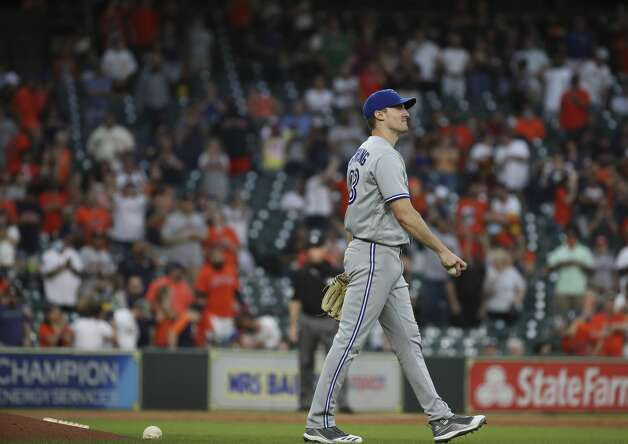 Toronto Blue Jays starting pitcher Ross Stripling (48) watches the replay after walking Houston Astros third baseman Alex Bregman (2) to bring in a run during the second inning of an MLB game Friday, May 7, 2021, at Minute Maid Park in Houston. Photo: Jon Shapley/Staff Photographer / © 2021 Houston Chronicle