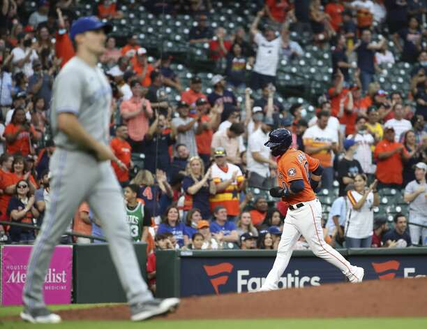 Houston Astros first baseman Yuli Gurriel (10) raounds the bases on a home run by shortstop Carlos Correa (1) during the second inning of an MLB game Friday, May 7, 2021, at Minute Maid Park in Houston. Photo: Jon Shapley/Staff Photographer / © 2021 Houston Chronicle