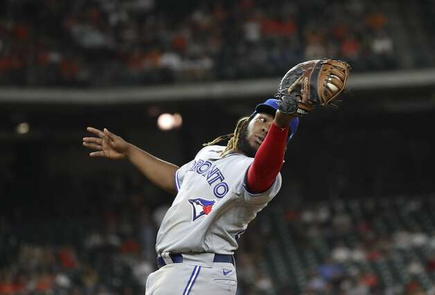 Toronto Blue Jays first baseman Vladimir Guerrero Jr. (27) catches a fly ball from Houston Astros catcher Martin Maldonado (15) during the fourth inning of an MLB game Friday, May 7, 2021, at Minute Maid Park in Houston. Photo: Jon Shapley/Staff Photographer / © 2021 Houston Chronicle