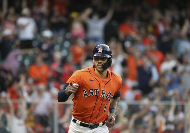 Houston Astros shortstop Carlos Correa (1) points at the dugout as he rounds the bases after hitting a home run during the second inning of an MLB game Friday, May 7, 2021, at Minute Maid Park in Houston. Photo: Jon Shapley/Staff Photographer / © 2021 Houston Chronicle