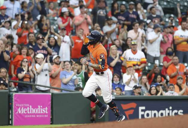 Houston Astros shortstop Carlos Correa (1) rounds the bases after hitting a home run during the second inning of an MLB game Friday, May 7, 2021, at Minute Maid Park in Houston. Photo: Jon Shapley/Staff Photographer / © 2021 Houston Chronicle