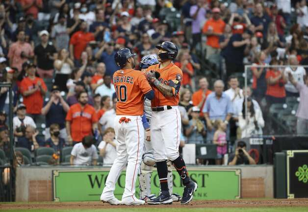 Houston Astros shortstop Carlos Correa (1) celebrates with Houston Astros first baseman Yuli Gurriel (10) after hittinng a home run during the second inning of an MLB game Friday, May 7, 2021, at Minute Maid Park in Houston. Photo: Jon Shapley/Staff Photographer / © 2021 Houston Chronicle