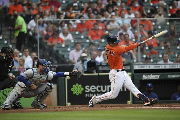 Houston Astros third baseman Alex Bregman (2) singles during the first inning of an MLB game on Friday, May 7, 2021, at Minute Maid Park in Houston. Photo: Jon Shapley/Staff Photographer / © 2021 Houston Chronicle