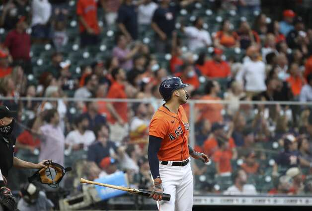Houston Astros shortstop Carlos Correa (1) watches his home run during the second inning of an MLB game Friday, May 7, 2021, at Minute Maid Park in Houston. Photo: Jon Shapley/Staff Photographer / © 2021 Houston Chronicle