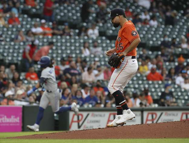 Houston Astros starting pitcher Jose Urquidy (65) waits as Toronto Blue Jays shortstop Bo Bichette (11) rounds the bases after hitting a home run during the first inning of an MLB game on Friday, May 7, 2021, at Minute Maid Park in Houston. Photo: Jon Shapley/Staff Photographer / © 2021 Houston Chronicle