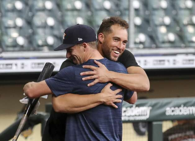 Former Houston Astros outfielder and current Toronto Blue Jays outfielder, on the IL, George Springer hugs Houston Astros center fielder Myles Straw (3) during Houston Astros batting practice before an MLB game against the Toronto Blue Jays on Friday, May 7, 2021, at Minute Maid Park in Houston. Photo: Jon Shapley/Staff Photographer / © 2021 Houston Chronicle