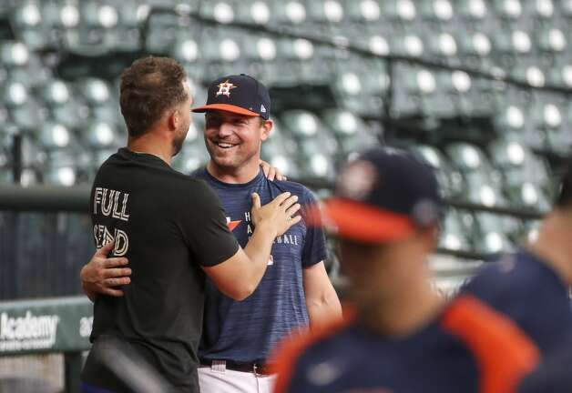 Houston Astros relief pitcher Joe Smith (38) talks with former Houston Astros outfielder and current Toronto Blue Jays outfielder, on the IL, George Springer during Houston Astros batting practice before an MLB game against the Toronto Blue Jays on Friday, May 7, 2021, at Minute Maid Park in Houston. Photo: Jon Shapley/Staff Photographer / © 2021 Houston Chronicle