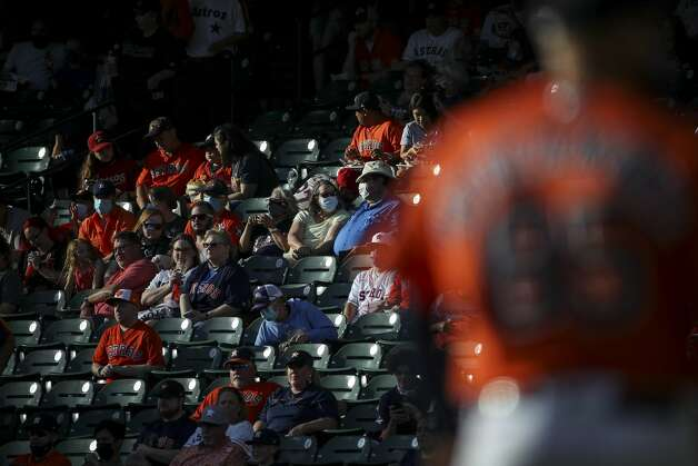 Fans wait for the start of an MLB game between the Houston Astros and the Toronto Blue Jays on Friday, May 7, 2021, at Minute Maid Park in Houston. Photo: Jon Shapley/Staff Photographer / © 2021 Houston Chronicle