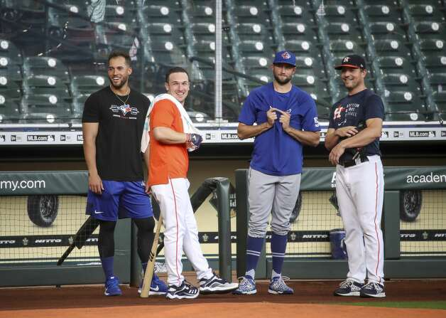 Former Houston Astros outfielder and current Toronto Blue Jays outfielder, on the IL, George Springer, from left, Houston Astros third baseman Alex Bregman (2), Toronto Blue Jays relief pitcher Tim Mayza (58) and Houston Astros relief pitcher Joe Smith (38) watch Houston Astros batting practice before an MLB game against the Toronto Blue Jays on Friday, May 7, 2021, at Minute Maid Park in Houston. Photo: Jon Shapley/Staff Photographer / © 2021 Houston Chronicle