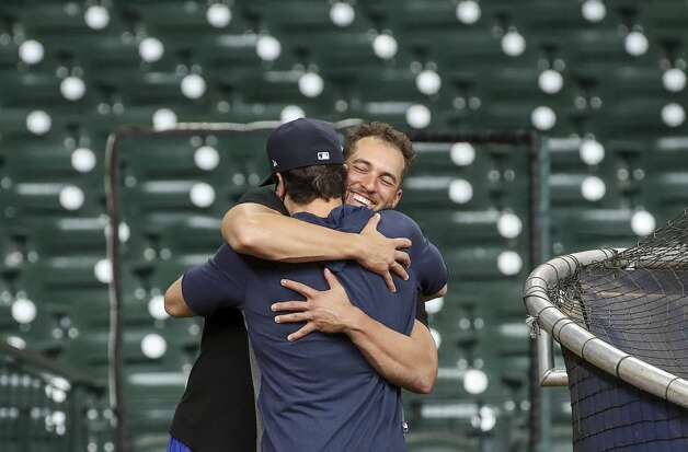 Former Houston Astros outfielder and current Toronto Blue Jays outfielder, on the IL, George Springer hugs hitting coach Troy Snitker during Houston Astros batting practice before an MLB game against the Toronto Blue Jays on Friday, May 7, 2021, at Minute Maid Park in Houston. Photo: Jon Shapley/Staff Photographer / © 2021 Houston Chronicle