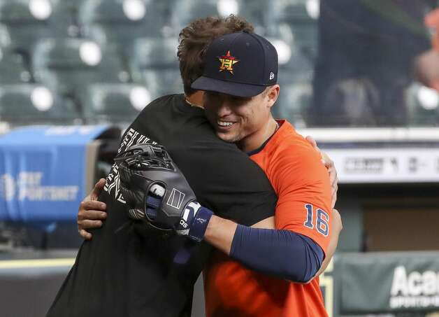 Houston Astros second baseman Aledmys Diaz (16) hugs former Astros outfielder George Springer during Houston Astros batting practice before an MLB game against the Toronto Blue Jays on Friday, May 7, 2021, at Minute Maid Park in Houston. Photo: Jon Shapley/Staff Photographer / © 2021 Houston Chronicle