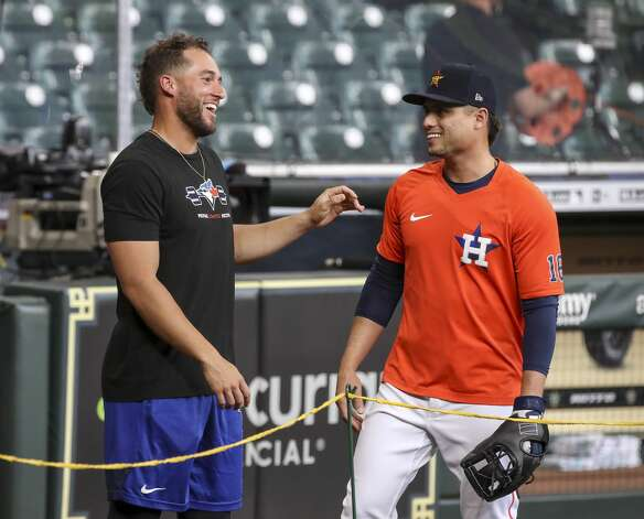 Former Houston Astros outfielder and current Toronto Blue Jays outfielder, on the IL, George Springer jokes with Houston Astros second baseman Aledmys Diaz (16) during Houston Astros batting practice before an MLB game against the Toronto Blue Jays on Friday, May 7, 2021, at Minute Maid Park in Houston. Photo: Jon Shapley/Staff Photographer / © 2021 Houston Chronicle