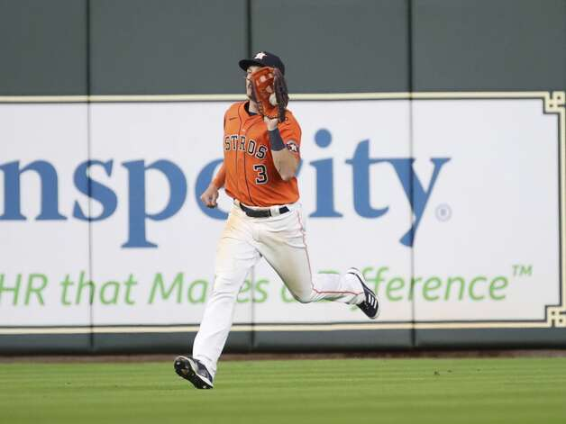 Houston Astros center fielder Myles Straw (3) catches a fly ball hit by Toronto Blue Jays left fielder Lourdes Gurriel Jr. (13) during the ninth inning of an MLB game Friday, May 7, 2021, at Minute Maid Park in Houston. Photo: Jon Shapley/Staff Photographer / © 2021 Houston Chronicle