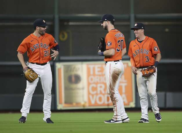 Houston Astros right fielder Chas McCormick (20), left fielder Kyle Tucker (30) and center fielder Myles Straw (3) celebrate after the Houston Astros beat the Toronto Blue Jays on Friday, May 7, 2021, at Minute Maid Park in Houston. Photo: Jon Shapley/Staff Photographer / © 2021 Houston Chronicle