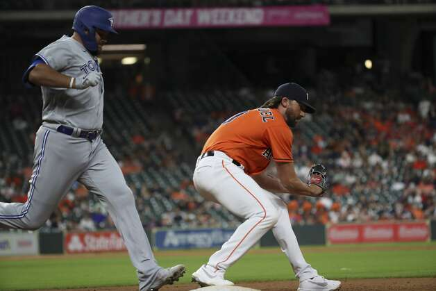 Houston Astros relief pitcher Kent Emanuel (0) gets Toronto Blue Jays designated hitter Rowdy Tellez (44) out at first during the ninth inning of an MLB game Friday, May 7, 2021, at Minute Maid Park in Houston. Photo: Jon Shapley/Staff Photographer / © 2021 Houston Chronicle